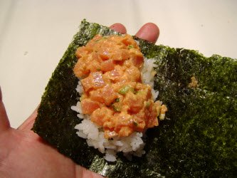 Adding spicy tuna to hand roll