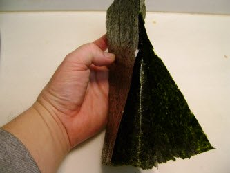 Bending the sheet the other way to help break the nori...