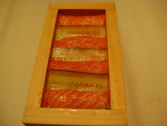 Showing top when salmon and cucumber have been layered