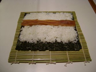Kampyo guord strips on sushi rice for futomaki