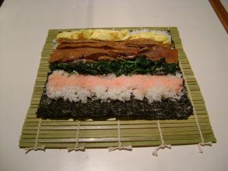 Adding sakura denbu across rice for futomaki-add twice as much as I did hear if you want to taste it