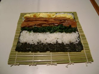 Adding tamago to sushi rice
