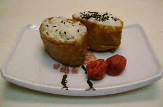 Inari sushi with umeboshi on a white sushi plate
