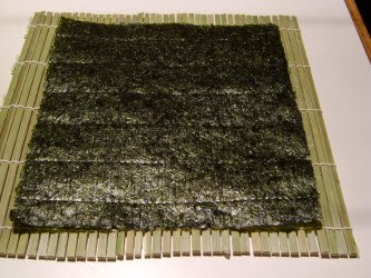 Full sheet on nori on sushi mat makisu