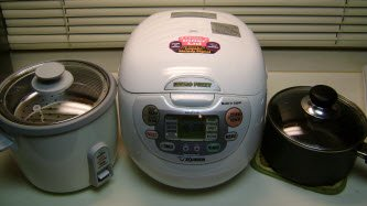 From left to right: Standard Rice cooker, fancy rice cooker and a plain old pot