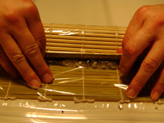 Keep rolling until the mat touches down on the nori on the far side of the roll...