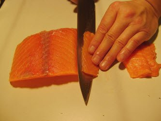 Slicing Salmon for sashimi or nigiri