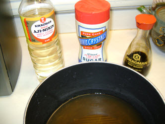 Combine dashi, sugar and mirin in a pot and add the kampyo, lotus root and unseasoned abura age (if not using inarizushi-no-moto)