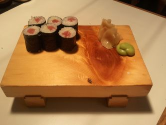 Finished hosomaki roll on sushi plate