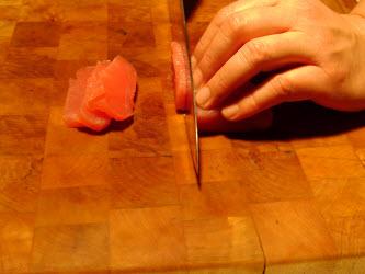 Cutting 1/4 inch slabs off of sushi grade tuna block using straight cut