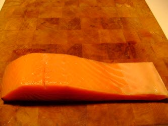 cold smoked salmon on cutting block
