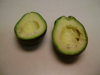 Splitting avocado in half