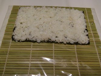 Spread the rice all over the nori sheet
