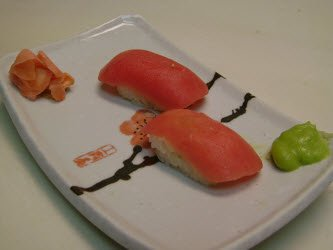 Two nigiri on a sushi plate just like they came out of the Sushi Magic nigiri mold