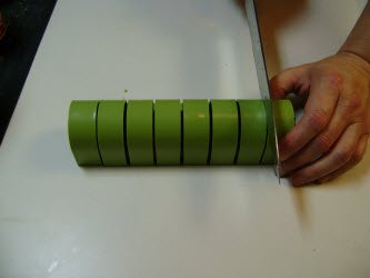 Slicing the roll with the sushiquik guide...I did like this...