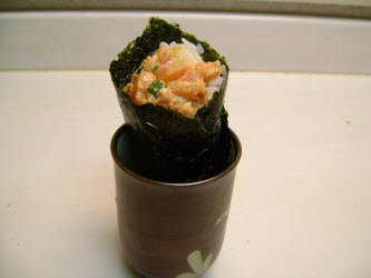 Spicy tuna hand roll in a japanese tea cup