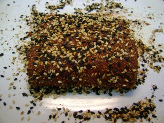 Tuna with black and white sesame seeds pressed into the flesh