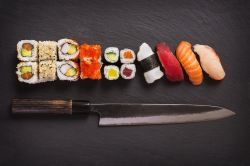 Sashimi knife with different kinds of maki sushi